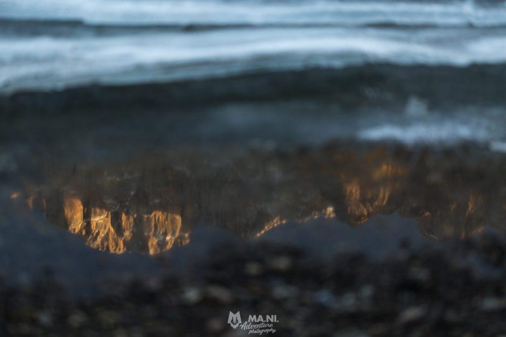 La Civetta al tramonto riflette i suoi colori nel lago di Alleghe